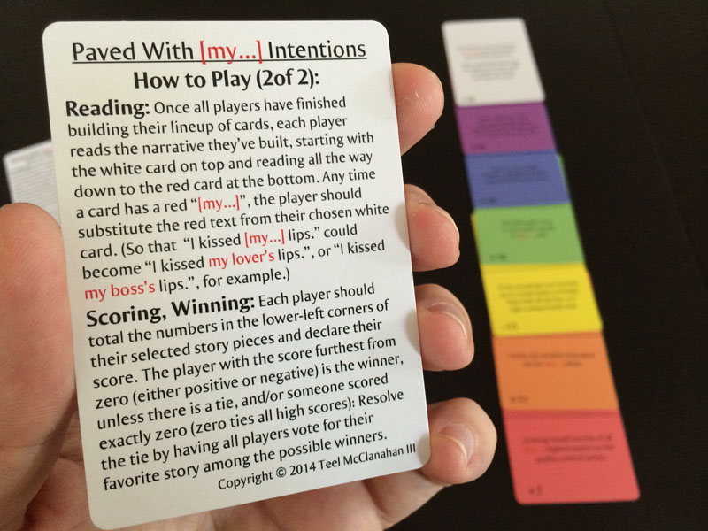 Second part of the Instructions, with a sample lineup of cards in the background, from Paved With [my...] Intentions, a card game by Teel McClanahan III, from Modern Evil Press